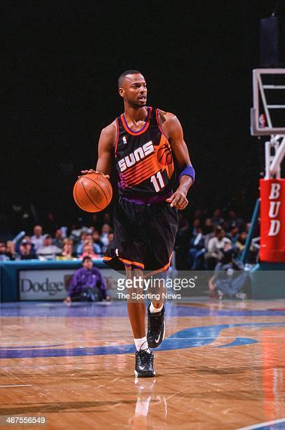 Todd Day of the Phoenix Suns moves the ball during the game against the Charlotte Hornets on January 29 2000 at Charlotte Coliseum in Charlotte North...