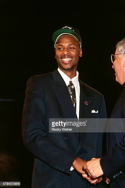 Todd Day shakes hands with NBA Commissioner David Stern after he was selected number eight overall by the Milwaukee Bucks during the 1992 NBA Draft...