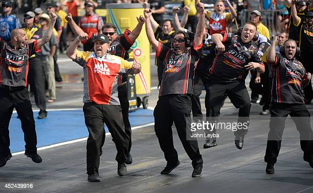 Todd defeats Brittany Force to take the Top Fuel title as the crew celebrates at the start line during the MOPAR Mile High Nationals July 20, 2014 at...