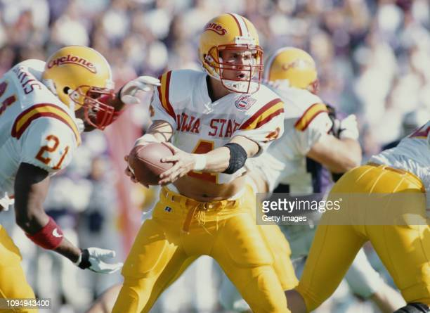 Todd Doxzon Quarterback for the Iowa State Cyclones hands the ball off to Running Back Graston Norris during the NCAA Big Eight Conference college...