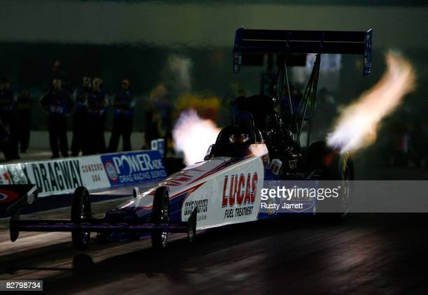 Todd driver of the Lucas top fuel dragster pulls the front wheels as he leaves during second round qualifying for the NHRA Carolinas Nationals at the...