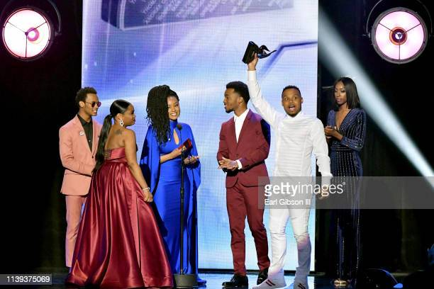 "Todd Dulaney accepts the ""Praise and Worship CD of the Year"" award from Jelani Winston, Katlyn Nichol and Christopher Jefferson during the 34th..."