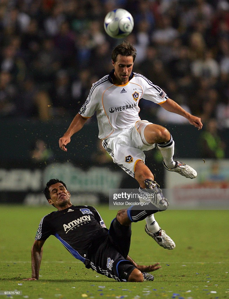 Todd Dunivan #2 of the Los Angeles Galaxy and Ramon Sanchez #20 of the San Jose Earthquakes vie for the ball in the first half during the MLS match at The Home Depot Center on October 24, 2009 in Carson, California.