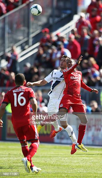 Todd Dunivant of the Los Angeles Galaxy goes up for a ball against Robert Earnshaw of the Toronto FC in an MLS game on March 30 2013 at BMO Field in...