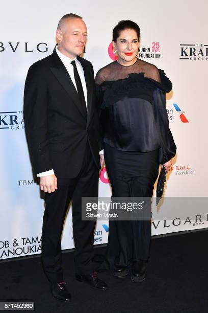 Todd Eckert and Marina Abramovic attend the Elton John AIDS Foundation's Annual Fall Gala with Cocktails By Clase Azul Tequila at Cathedral of St...
