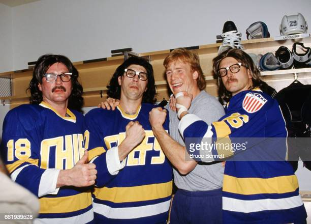 Todd Ewen of the Mighty Ducks of Anaheim poses for a portrait with the Hanson Brothers from the movie Slapshot Jack Hanson Steve Hanson and Jeff...