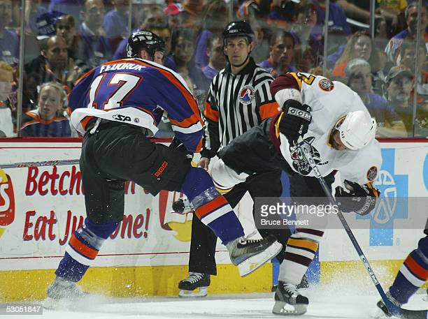 Todd Fedoruk of the Philadelphia Phantoms collides with Brad Larsen of the Chicago Wolves during the American Hockey League Calder Cup final game at...