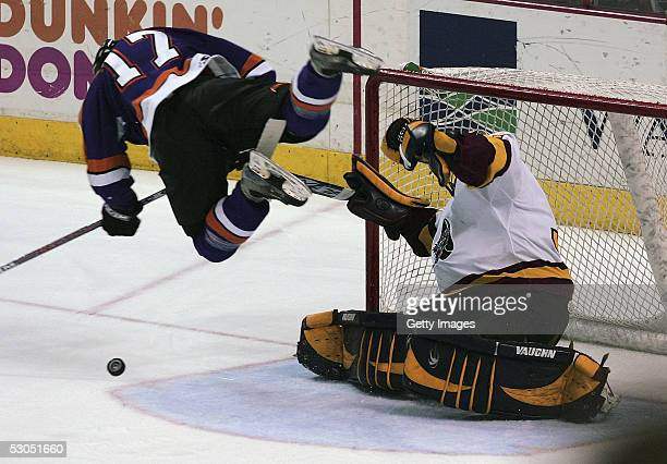Todd Fedoruk of the Philadelphia Phantoms flys past Kari Lehtonen of the Chicago Wolves during second period action The Phantoms defeated the Chicago...