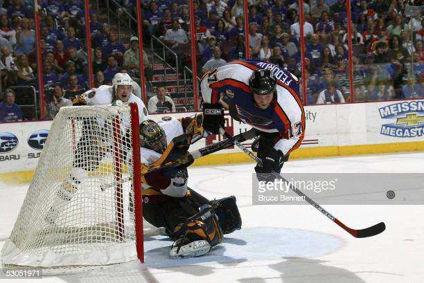 Todd Fedoruk of the Philadelphia Phantoms sails past Kari Lehtonen of the Chicago Wolves during game four of the Calder Cup Championship where the...