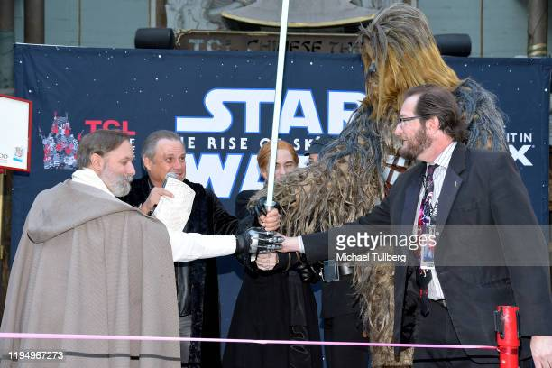 """Todd Fisher, brother of the late actress Carrie Fisher and """"Star Wars"""" characters cut a ceremonial ribbon at the IMAX opening of """"Star Wars: The Rise..."""