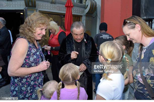 """Todd Fisher, brother of the late actress Carrie Fisher, chats with young fans at the IMAX opening of """"Star Wars: The Rise Of Skywalker"""" at TCL..."""