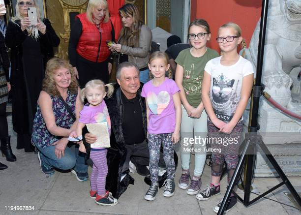 """Todd Fisher , brother of the late actress Carrie Fisher, poses with fans at the IMAX opening of """"Star Wars: The Rise Of Skywalker"""" at TCL Chinese..."""