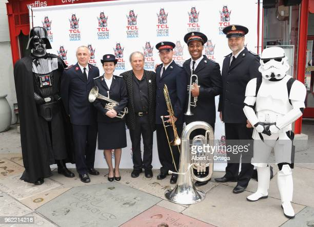 Todd Fisher Darth Vader and a Storm Trooper pose beside the Salvation Army Band in front of the TCL Chinese Theater on May 24 2018 in Hollywood...