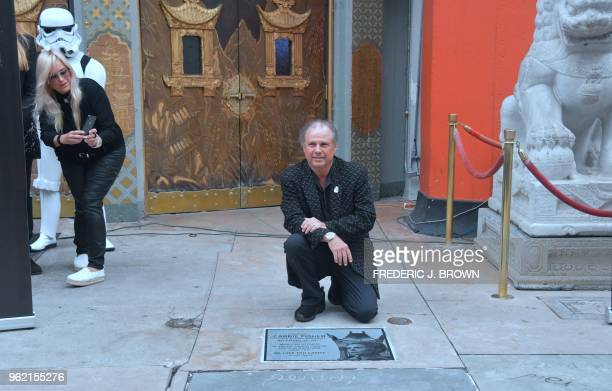 Todd Fisher poses at the etched granite plaque for his sister the late Carrie Fisher unveiled in front of the TCL Chinese Theater on May 24 2018 in...