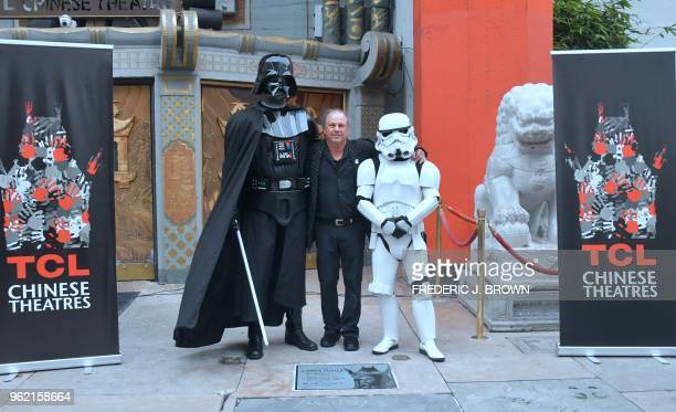 Todd Fisher poses with characters dressed as Darth Vader and a Stormtrooper beside the etched granite plaque for his sister the late Carrie Fisher...