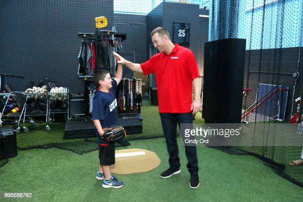 Todd Frazier and a player from the the Toms River Little League at the Canon #PIXMAPerfect Grand Slam event at New York Empire Baseball on July 10...