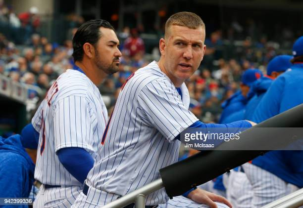 Todd Frazier and Adrian Gonzalez of the New York Mets look on against the St Louis Cardinals during Opening Day at Citi Field on March 29 2018 in the...