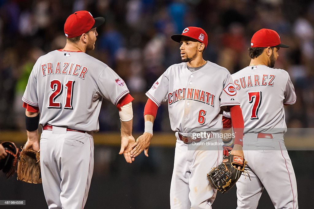 Todd Frazier #21 and Billy Hamilton #6 of the Cincinnati Reds celebrate a win over the Colorado Rockies after a game at Coors Field on July 25, 2015 in Denver, Colorado.