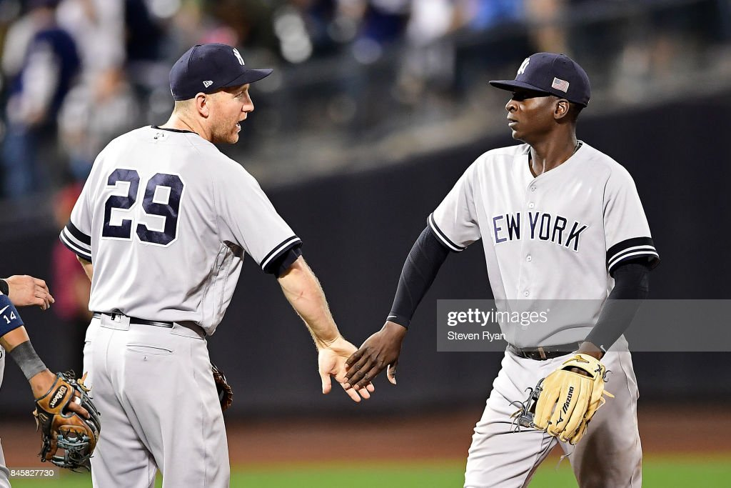 Todd Frazier #29 and Didi Gregorius #18 of the New York Yankees celebrate their teams 5-1 victory over the Tampa Bay Rays at Citi Field on September 11, 2017 in the Flushing neighborhood of the Queens borough of New York City. The two teams were scheduled to play in St. Petersburg, but due to the weather emergency caused by Hurricane Irma, the game was moved to New York, but with Tampa Bay remaining the 'home' team.