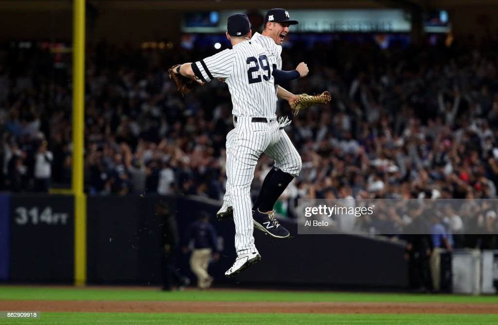 Todd Frazier #29 and Greg Bird #33 of the New York Yankees celebrate after defeating the Houston Astros in Game Five of the American League Championship Series at Yankee Stadium on October 18, 2017 in the Bronx borough of New York City. The New York Yankees defeated the Houston Astros 5-0.