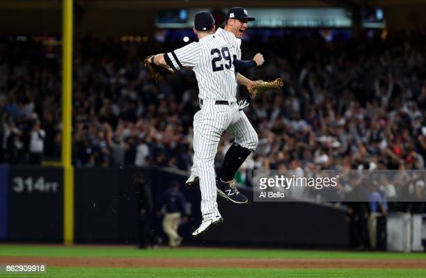 Todd Frazier and Greg Bird of the New York Yankees celebrate after defeating the Houston Astros in Game Five of the American League Championship...