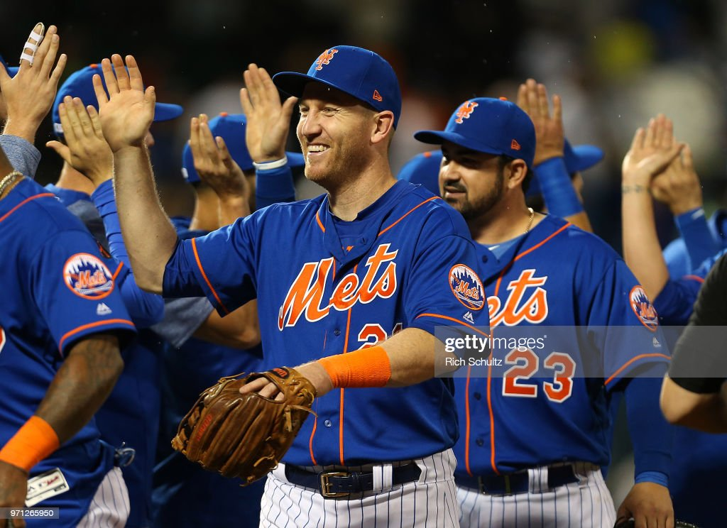 Todd Frazier #21 and his New York Mets teammates celebrate their 2-0 win over the New York Yankees during a game at Citi Field on June 10, 2018 in the Flushing neighborhood of the Queens borough of New York City.