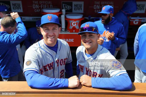 Todd Frazier and Michael Conforto of the New York Mets pose for a photo in the dugout prior to the game against the Washington Nationals at Nationals...