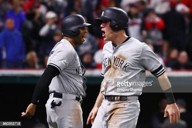 Todd Frazier celebrates with Aaron Hicks of the New York Yankees after scoring on a single by Brett Gardner in the ninth inning against the Cleveland...