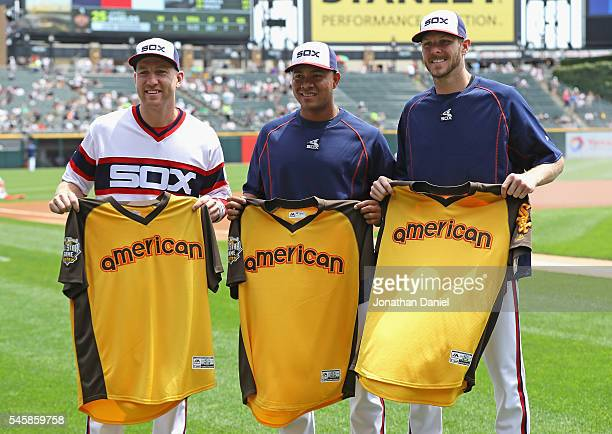 Todd Frazier Jose Quintana and Chris Sale of the Chicago White Sox hold their AllStar game jerseys before a game against the Atlanta Braves at US...