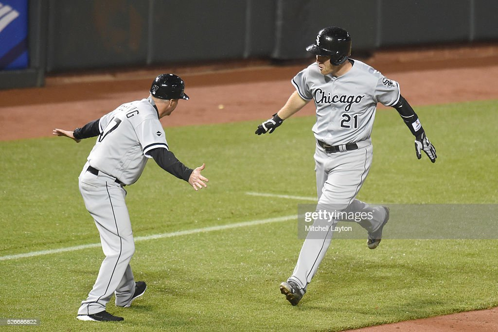 Todd Frazier #21 of the Chicago White Sox celebrates a two run home run with third base coach Dan Jennings #43 in the eight inning during a baseball game against the Baltimore Orioles at Oriole Park at Camden yards on April 30, 2016 in Baltimore, Maryland.