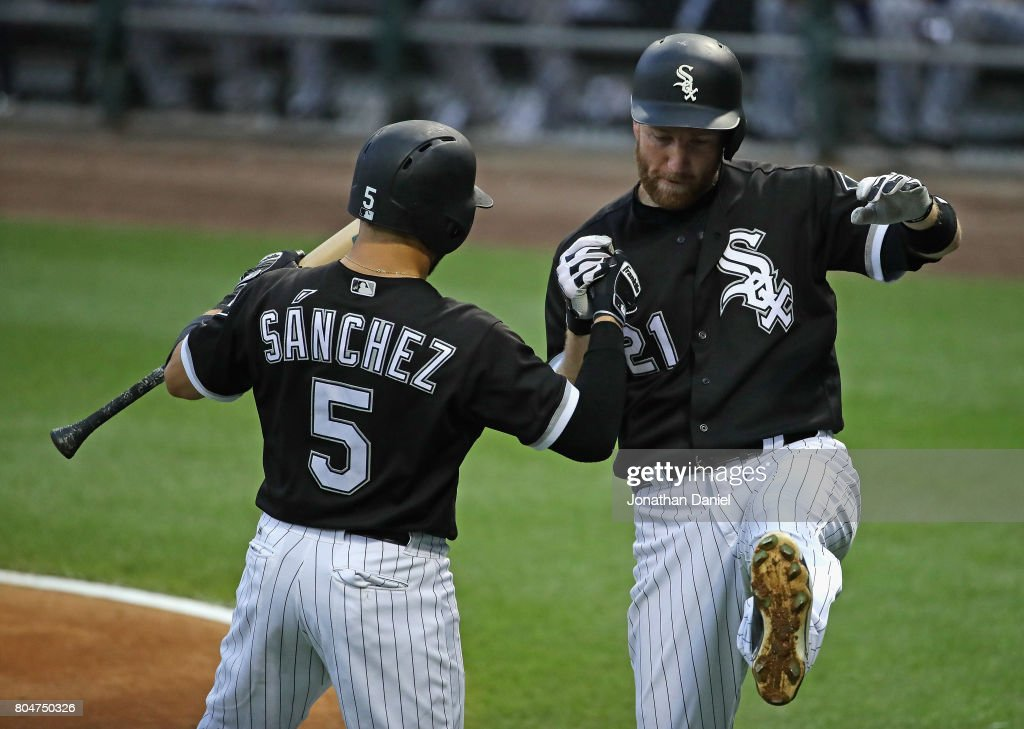 Todd Frazier #21 of the Chicago White Sox celebrates his 1st inning, solo home run with teammate Yolmer Sanchez #5 against the Texas Rangers at Guaranteed Rate Field on June 30, 2017 in Chicago, Illinois.