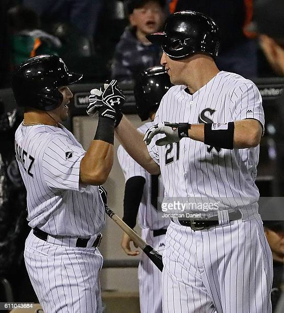 Todd Frazier of the Chicago White Sox celebrates his career high 40th home run of the season a solo shot in the 7th inning with teammate Carlos...