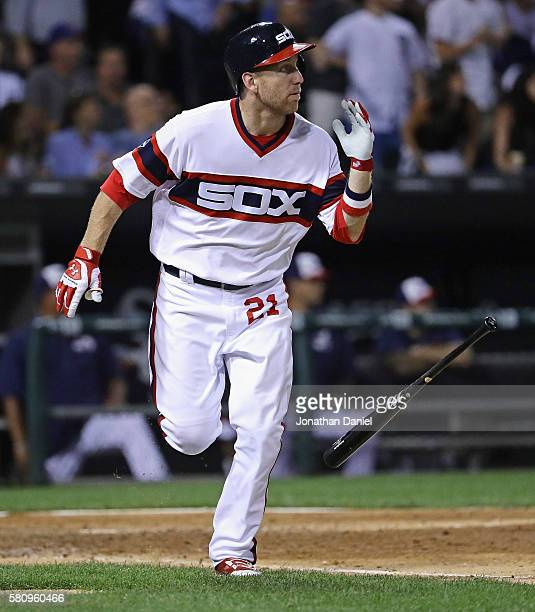 Todd Frazier of the Chicago White Sox flips his bat as he follows the flight of his three run home run in the 6th inning against the Chicago Cubs at...