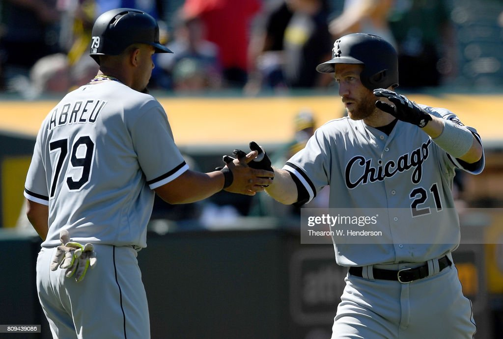 Todd Frazier #21 of the Chicago White Sox is congratulated by Jose Abreu #79 after Frazier hit a two-run homer against the Oakland Athletics in the top of the ninth inning at Oakland Alameda Coliseum on July 5, 2017 in Oakland, California.