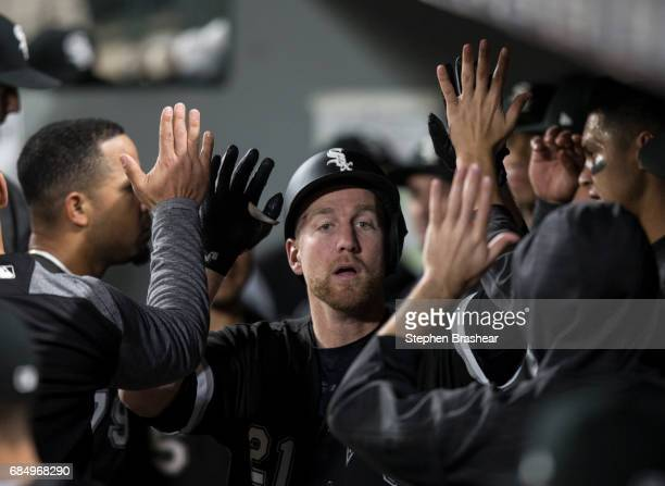 Todd Frazier of the Chicago White Sox is congratulated by teammates after hitting a solo home run off relief pitcher Dan Altavilla of the Seattle...