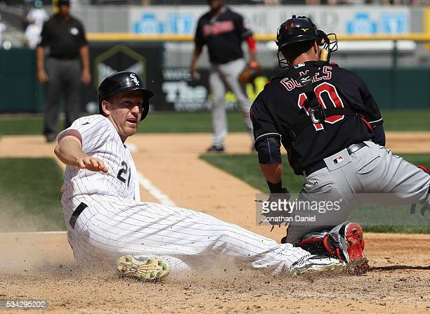 Todd Frazier of the Chicago White Sox slides in to score a run past Yan Gomes of the Cleveland Indians on a fielding error in the 6th inning at US...