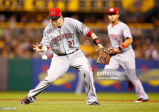 Todd Frazier of the Cincinnati Reds bare hands a ground ball against the Pittsburgh Pirates during the game at PNC Park on June 24 2015 in Pittsburgh...