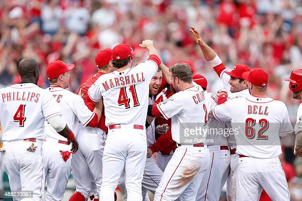 Todd Frazier of the Cincinnati Reds celebrates his winning hit with teammates after the game against the Milwaukee Brewers at Great American Ball...