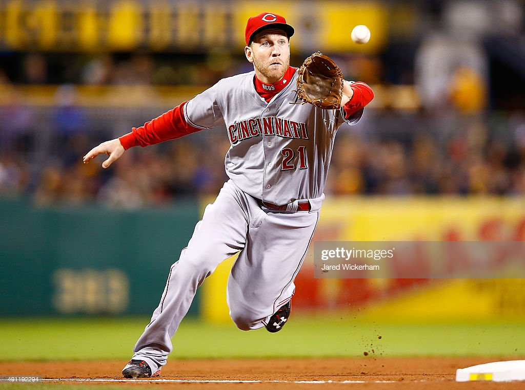 Todd Frazier #21 of the Cincinnati Reds fields a ground ball in the 6th inning against the Pittsburgh Pirates during the game at PNC Park on October 3, 2015 in Pittsburgh, Pennsylvania.