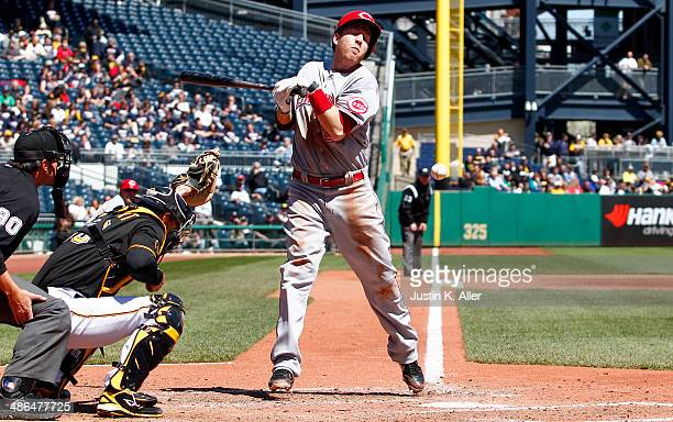 Todd Frazier of the Cincinnati Reds is hit by a pitch in the sixth inning against the Pittsburgh Pirates during the game at PNC Park April 24 2014 in...