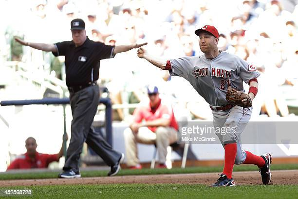 Todd Frazier of the Cincinnati Reds makes the throw to first base to retire Jonathan Lucroy of the Milwaukee Brewers during the bottom of the fifth...