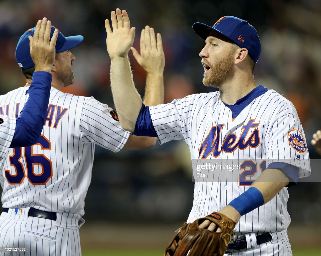 Todd Frazier #21 of the New York Mets celebrates the win with manager Mickey Callaway after the 5-3 win over the San Francisco Giants on August 22, 2018 at Citi Field in the Flushing neighborhood of the Queens borough of New York City.
