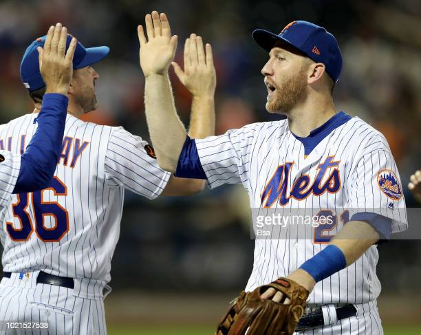 Todd Frazier of the New York Mets celebrates the win with manager Mickey Callaway after the 53 win over the San Francisco Giants on August 22 2018 at...