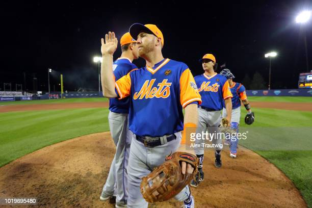 Todd Frazier of the New York Mets celebrates with teammates after the Mets defeated the Philadelphia Phillies in the 2018 Little League Classic at...