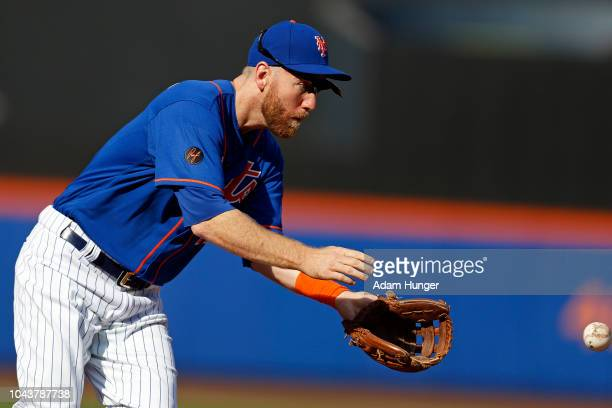 Todd Frazier of the New York Mets fields a ground out by Lewis Brinson of the Miami Marlins during the second inning at Citi Field on September 30...