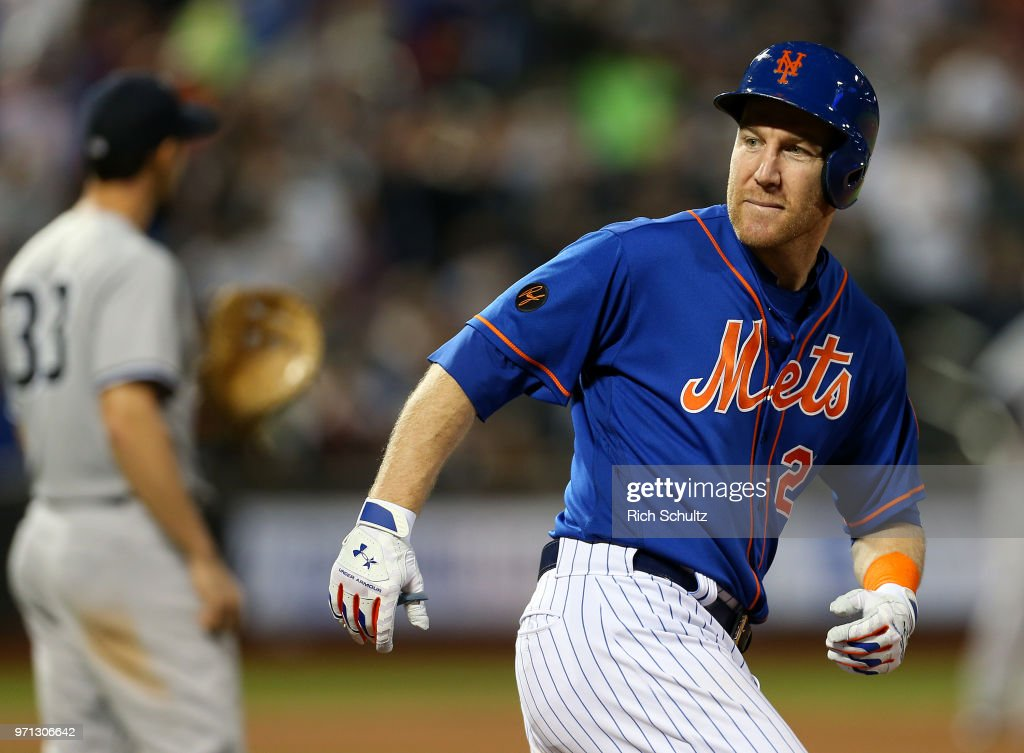 Todd Frazier #21 of the New York Mets looks into his dugout after he hit a two-run home run during the fifth inning against the New York Yankees during a game at Citi Field on June 10, 2018 in the Flushing neighborhood of the Queens borough of New York City. The Mets defeated the Yankees 2-0.