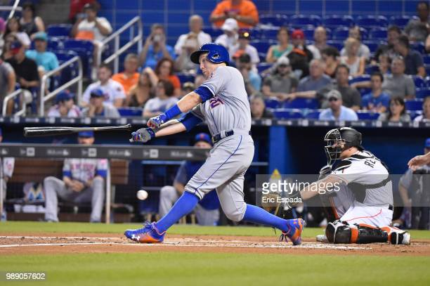 Todd Frazier of the New York Mets loses his bat as he swings at a pitch during the second inning against the Miami Marlins at Marlins Park on July 1...