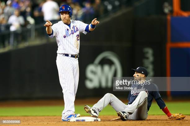 Todd Frazier of the New York Mets reacts after making it safely to second base on a single hit by Adrian Gonzalez in the ninth inning against the...