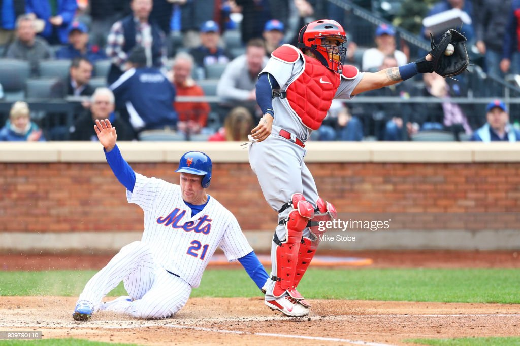 Todd Frazier #21 of the New York Mets scores on Adrian Gonzalez #23 RBI single in the fifth inning in front of Yadier Molina #4 of the St. Louis Cardinals on Opening Day at Citi Field on March 29, 2018 in the Flushing neighborhood of the Queens borough of New York City.