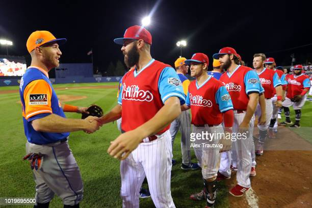 Todd Frazier of the New York Mets shakes hands with Jake Arrieta of the Philadelphia Phillies after the 2018 Little League Classic at Historic Bowman...